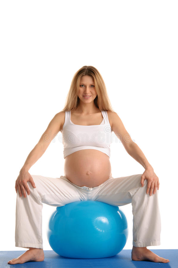 Free Pregnant Woman Practicing Yoga With Blue Ball Royalty Free Stock Images - 22777839
