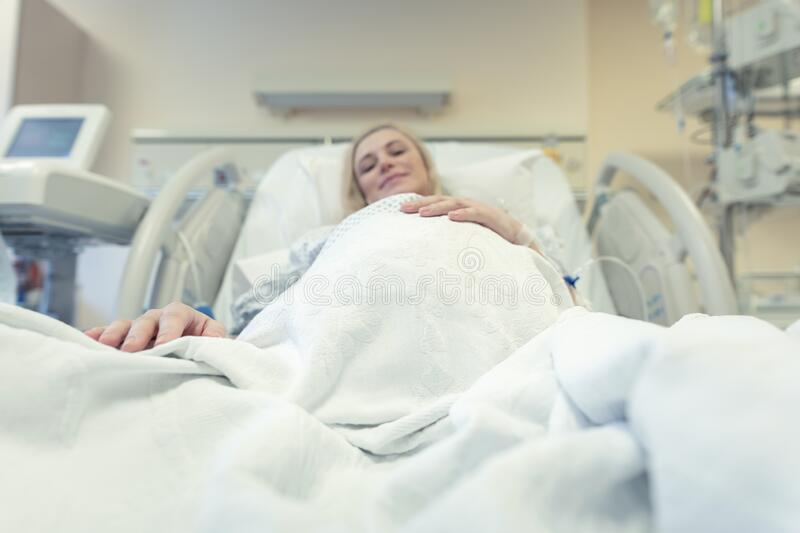 Pregnant woman in the prenatal clinic royalty free stock photo