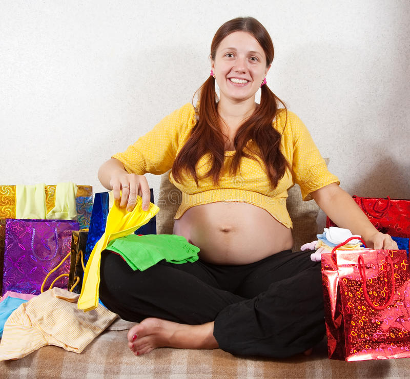 Pregnant Woman With Purchases Stock Images