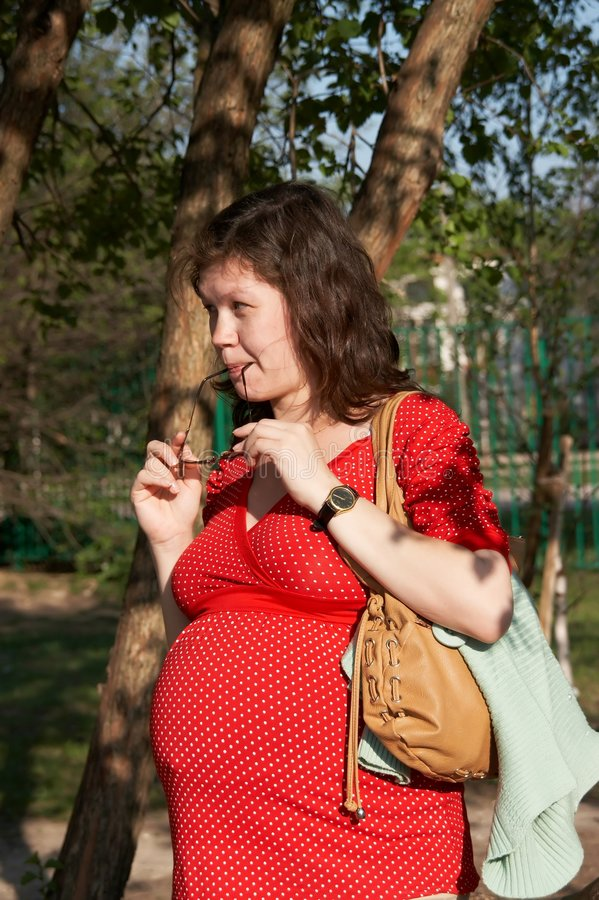Download Pregnant woman in red stock image. Image of young, anticipation - 5089485