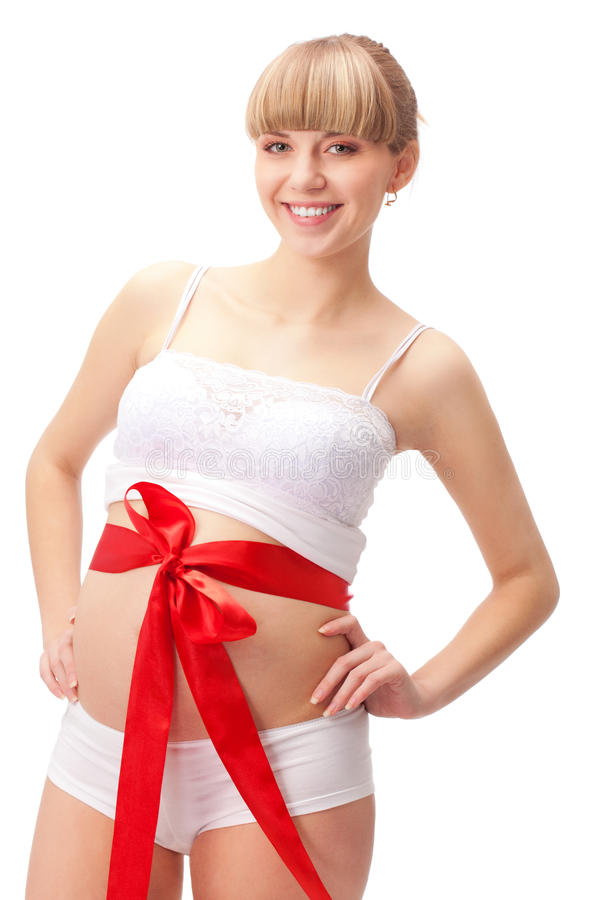 Pregnant woman with red bow on belly. Over white royalty free stock photography