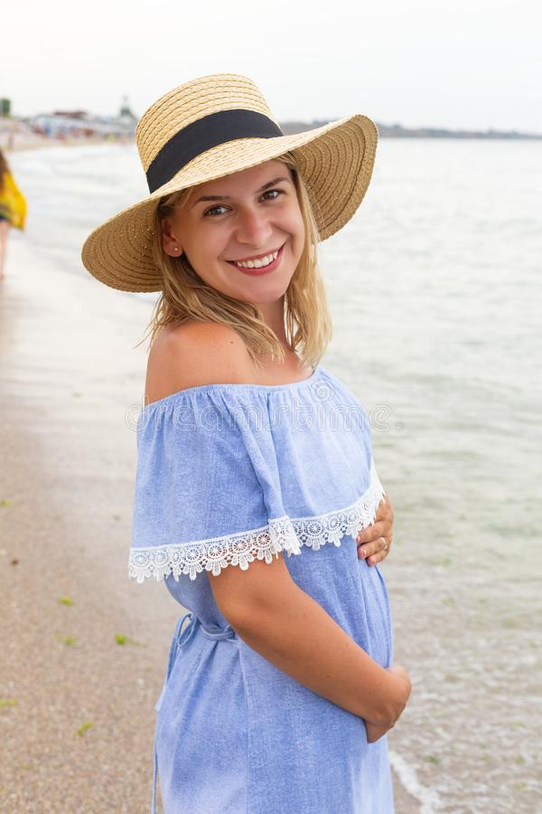 Pregnant woman at the seaside stock photography