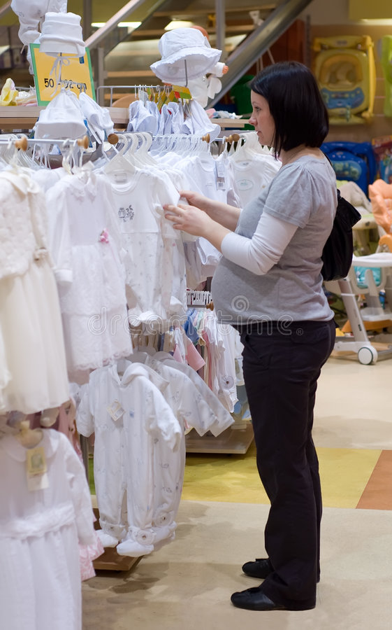 Pregnant woman shopping stock photo