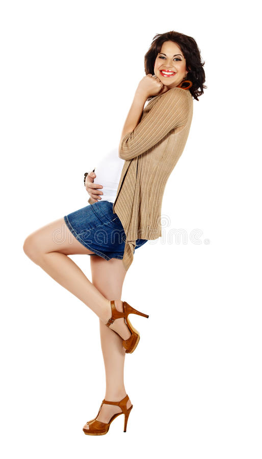 Pregnant woman in shorts royalty free stock image