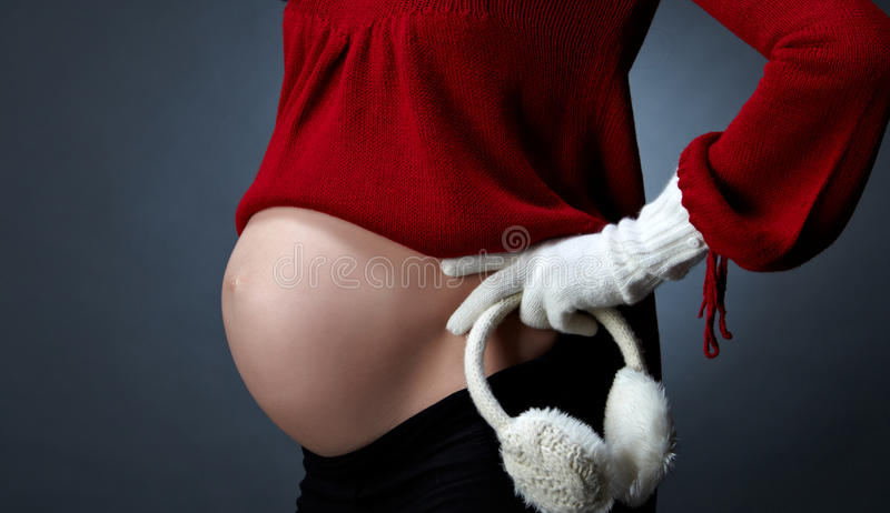 Pregnant woman showing her belly stock photo