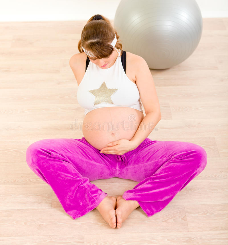 Download Pregnant Woman In Sportswear Holding Her Belly Stock Image - Image: 18633659