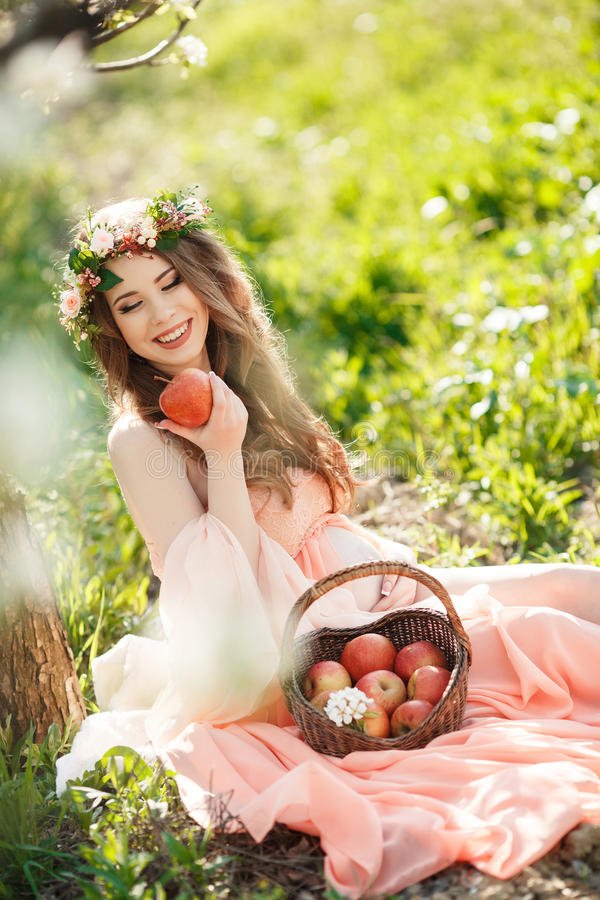 A pregnant woman in a spring garden with basket stock photos