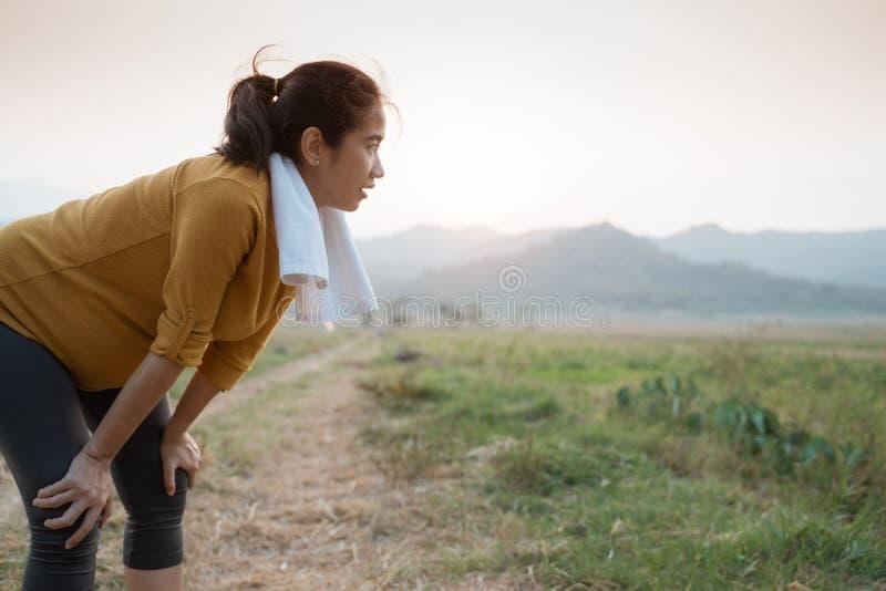 Pregnant woman take a break after sport. Pregnant woman take a break after doing sport outdoor royalty free stock photo