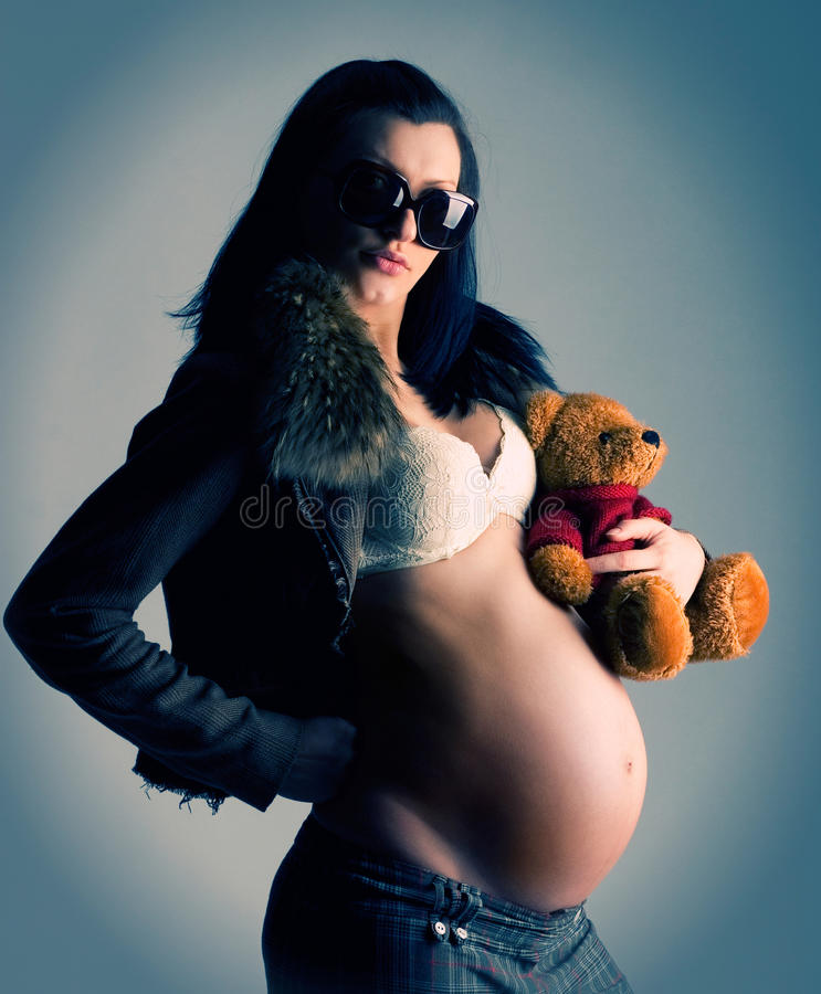 Pregnant woman with toy royalty free stock photos