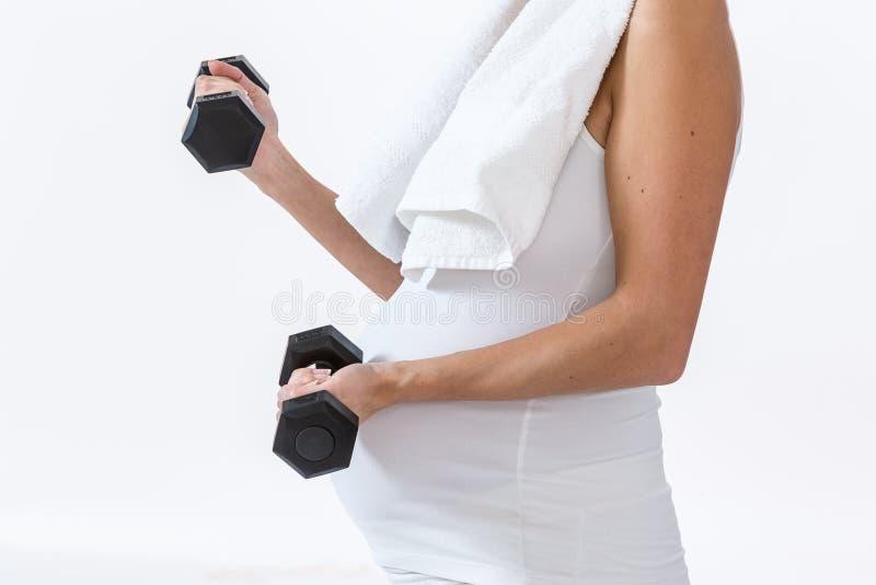 Pregnant woman using handweights stock photo