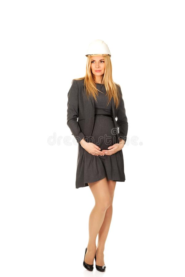 Pregnant woman in white helmet royalty free stock images