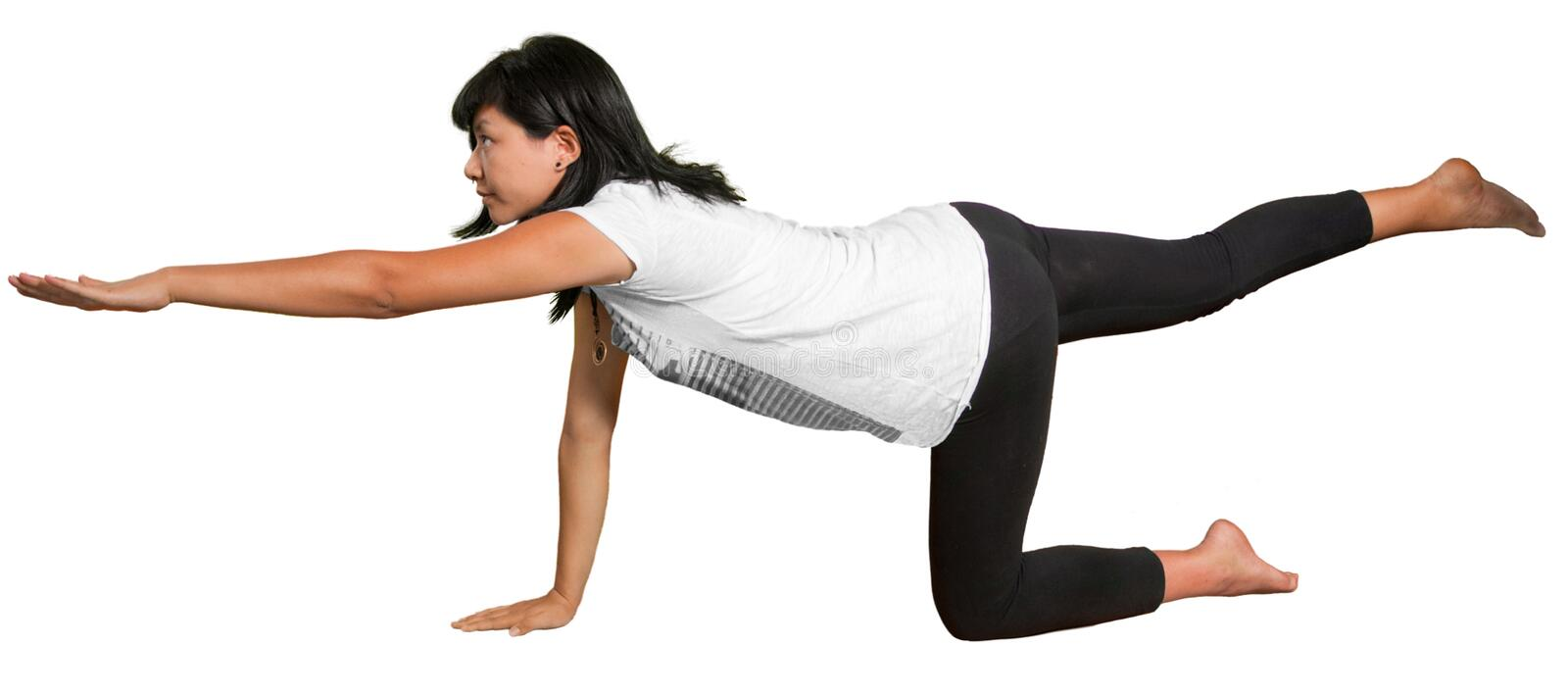 Pregnant woman in Yoga pose royalty free stock photo
