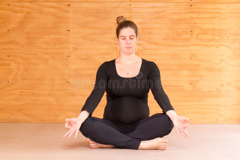 Pregnant woman yoga royalty free stock photography