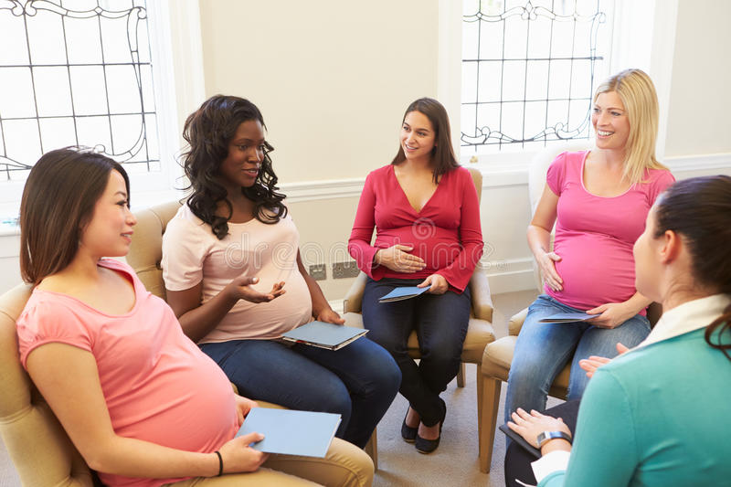 Pregnant Women Meeting At Ante Natal Class. Having A Discussion stock photos