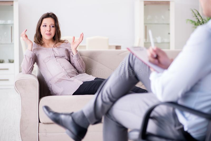 The pregnant woman visiting psychologist doctor. Pregnant women visiting psychologist doctor stock images