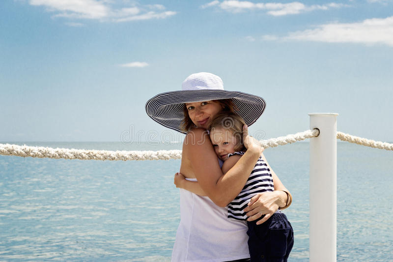 A pregnant young mother with a small daughter (3 years old) on t stock photos