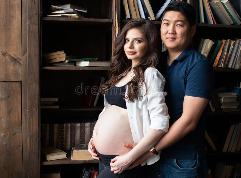 A pregnant young woman and a man stock image