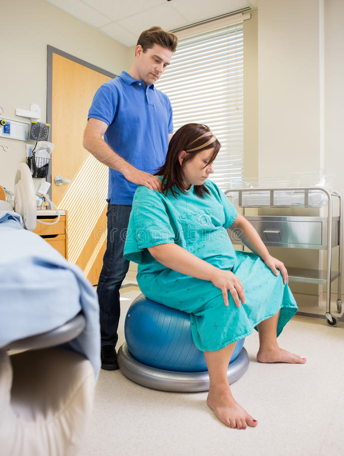 Pregnat Woman in Hosptail Using Exercise Ball stock photos