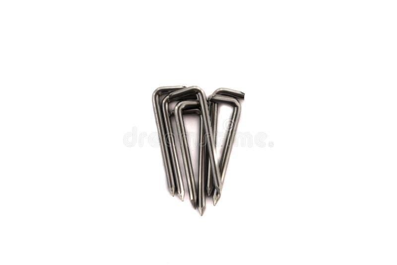 Pregos de aço no fundo branco foto de stock