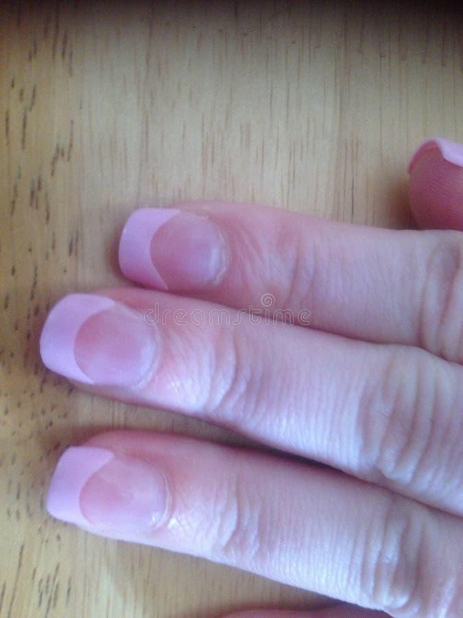 Pregos falsificados cor-de-rosa foto de stock