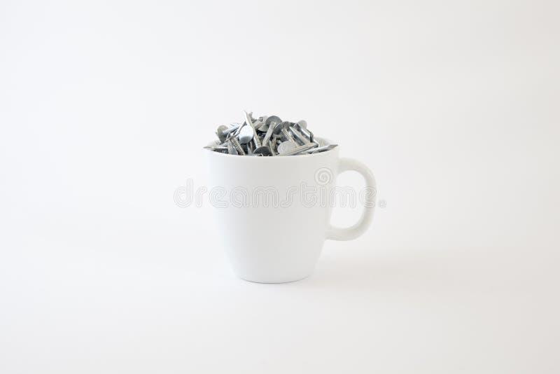 Download Pregos Principais Lisos Em Um Copo De Café Imagem de Stock - Imagem de ouch, carpinteiro: 12812981