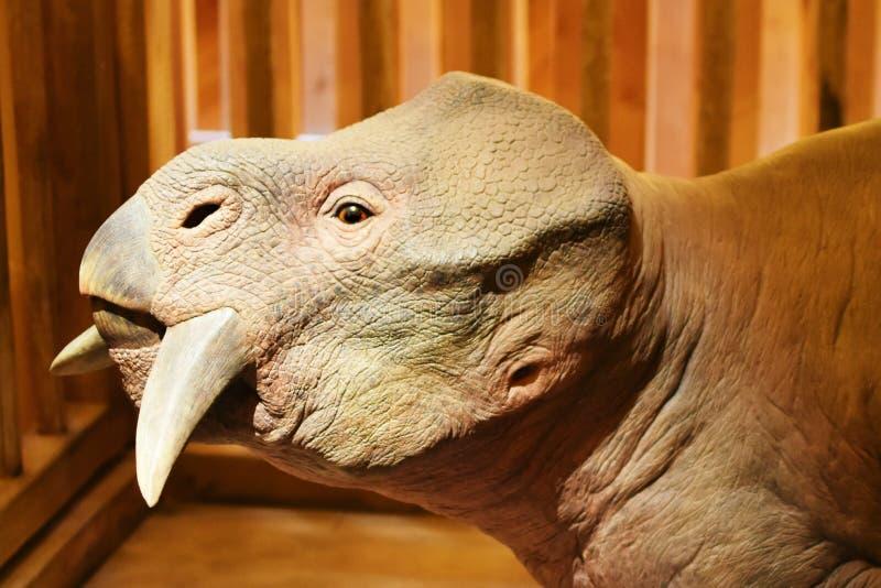 Prehistoric Animal - The Ark Encounter. An example of an extinct `kind` on the Ark Encounter in Williamstown, Kentucky. A life-sized replica of Noah`s ark from stock photo
