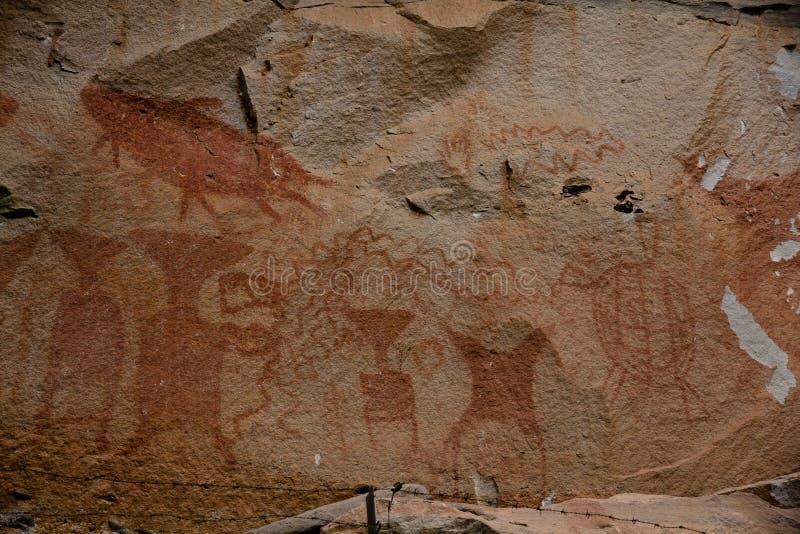 Prehistoric art paintings at cliff of Pha Taem. Ubon Rajchathani, Thailand stock photos