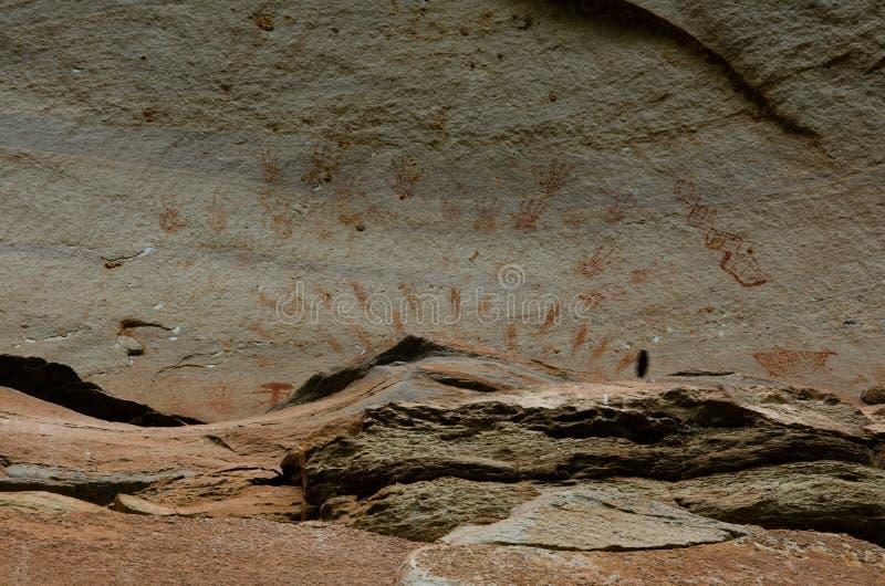 Prehistoric art paintings at cliff of Pha Taem. Ubon Rajchathani, Thailand royalty free stock image