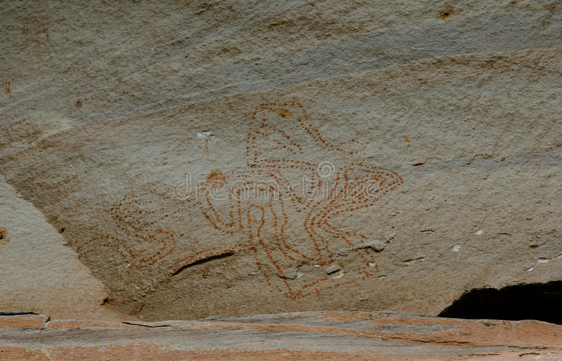 Prehistoric art paintings at cliff of Pha Taem. Ubon Rajchathani, Thailand royalty free stock photos