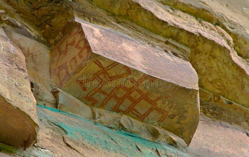 Prehistoric art paintings at cliff of Pha Taem. Ubon Rajchathani, Thailand royalty free stock photography