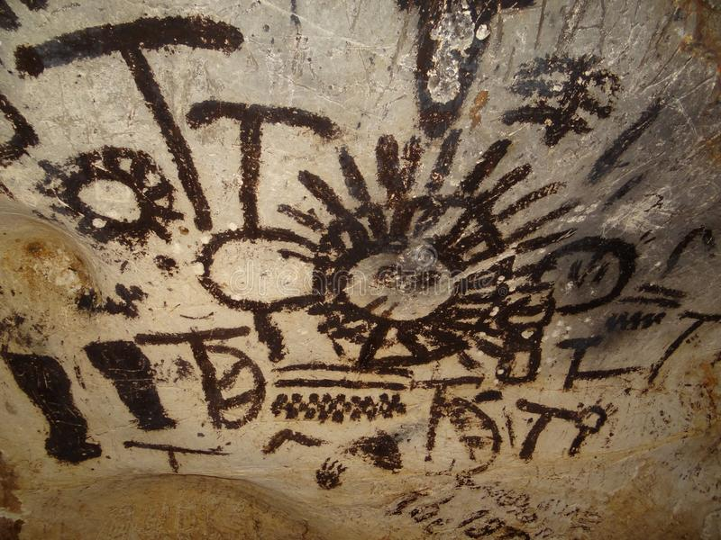 Prehistoric art wall paintng in neolithic cave Magura, Bulgaria. Popular cave painting from prehistoric people in Bulgaria royalty free stock images