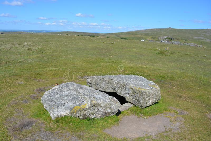 Prehistoric burial chamber Dartmoor National Park, Devon, UK. Cist burial chamber / dolmen with broken capstone, prehistoric antiquity associated with the stock photos