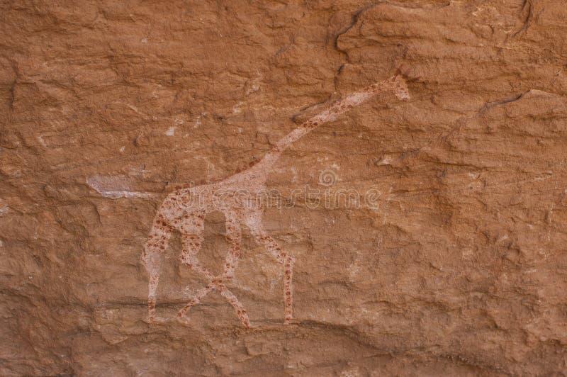 Prehistoric Petroglyphs in libian sahara desert. Prehistoric Petroglyphs - Rock Art - Akakus (Acacus) Mountains, Sahara, Libya royalty free stock photography