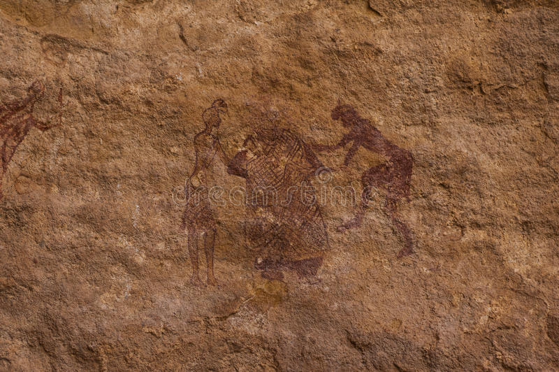 Prehistoric Petroglyphs in libian sahara desert. Prehistoric Petroglyphs - Rock Art - Akakus (Acacus) Mountains, Sahara, Libya royalty free stock images