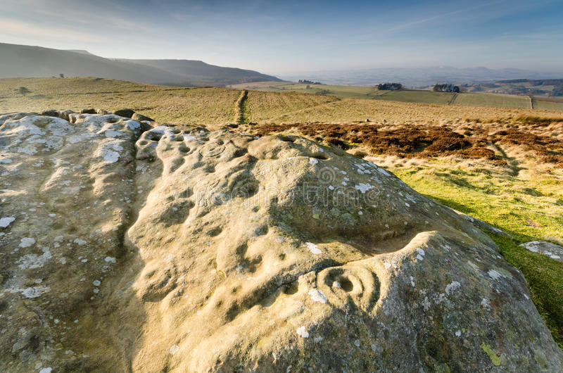 Prehistoric rock art. Ancient prehistoric cup and ring rock art is found on many stones at Lordenshaws in the Simonside Hills part of Northumberland National royalty free stock photo