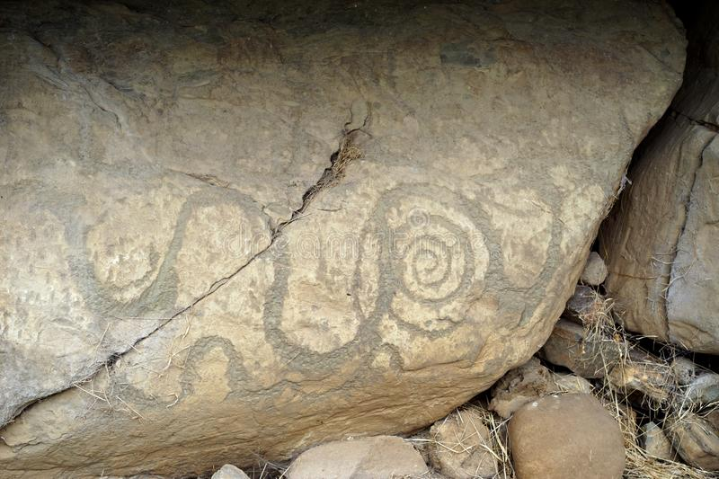 Prehistoric stone carvings are called petroglyphs. The passage tomb at Newgrange known as Brú na Bóinne in Gaelic served as a focus of ceremonial activity stock images