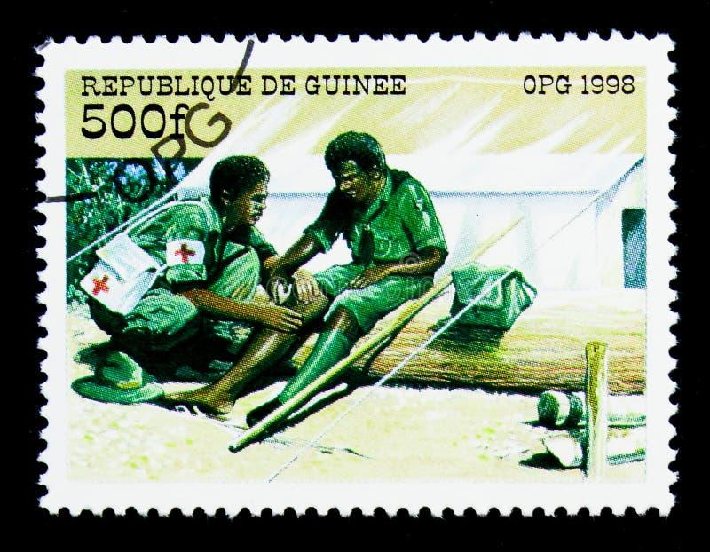 Premiers secours, le scout international Organization de quatre-vingt-dixième anniversaire images libres de droits
