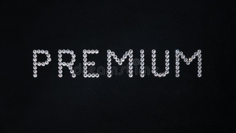 Premio di parola fatto dei cristalli bianchi brillanti di swarovski disposti su cuoio nero illustrazione di stock