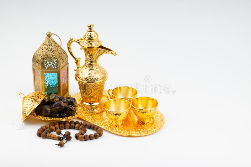 Premium dates, lantern and arabic coffee mug on white background. stock photos