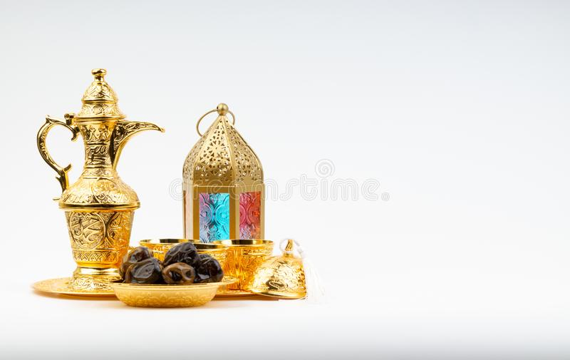 Premium dates, lantern and arabic coffee set on white background royalty free stock photos