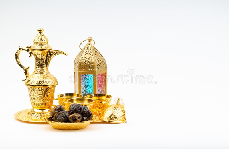 Premium dates, lantern and arabic coffee set on white background royalty free stock photography