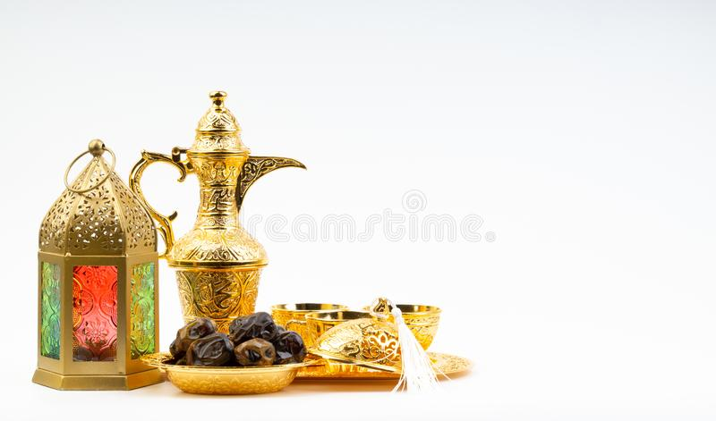 Premium dates, lantern and arabic coffee set on white background royalty free stock images