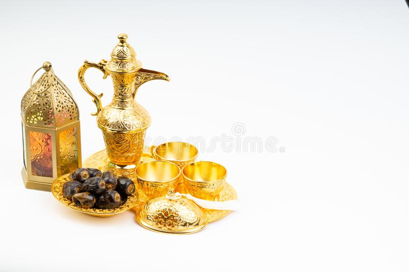 Premium dates, lantern and arabic coffee set on white background stock photography