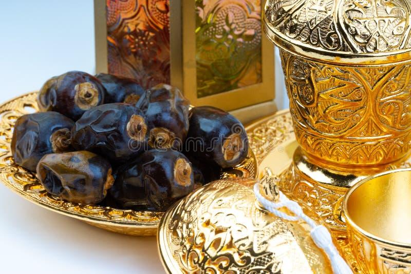 Premium dates, lantern and arabic coffee set on white background royalty free stock photography