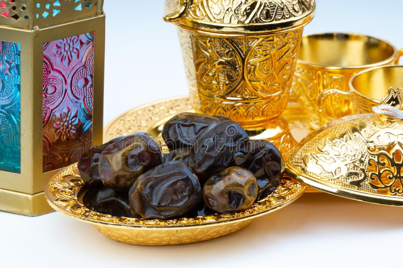 Premium dates, lantern and arabic coffee set on white background stock image
