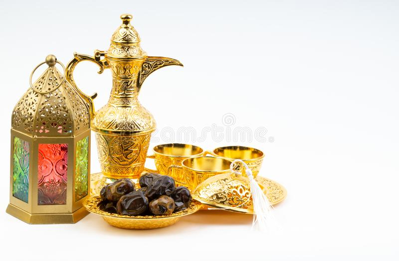 Premium dates, lantern and arabic coffee set on white background royalty free stock photo