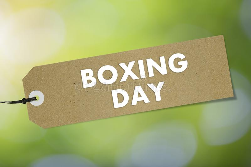 Brown Bio label with text Boxing Day on green sky background. Mockup royalty free stock photos