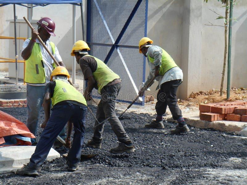 Premix het werk door bouwvakkers stock afbeelding