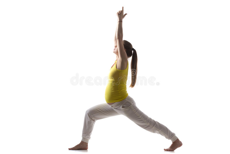 Prenatale Yoga, Virabhadrasana 1 royalty-vrije stock fotografie