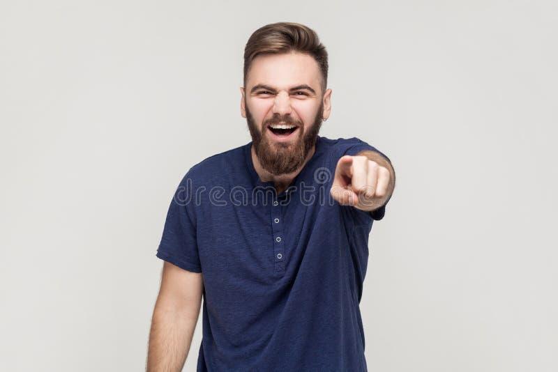Prenda in giro il concetto Derisione, cattivo scherzo Uomo che indica dito ed anche fotografia stock
